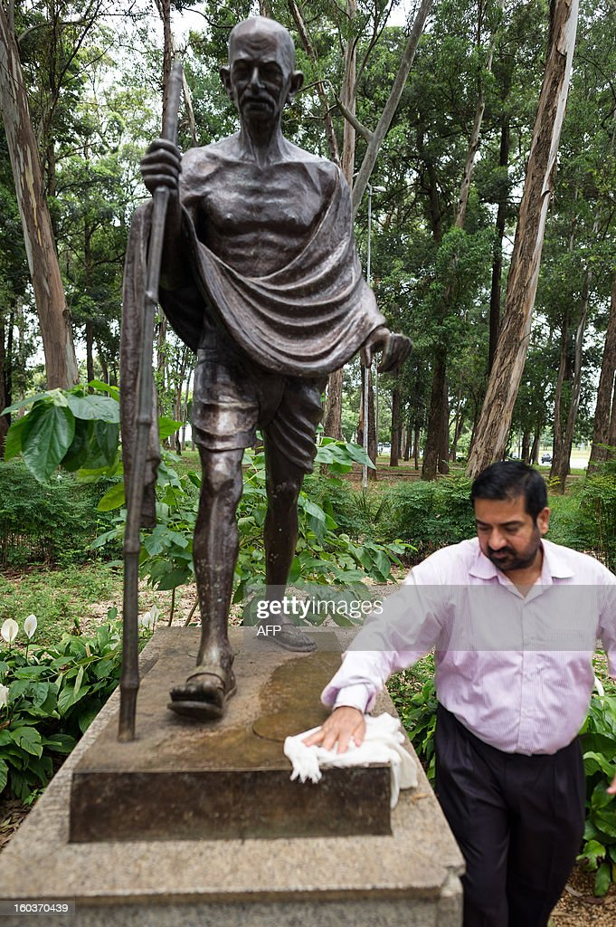 Shri Kamal Jit Singh, director of the Indian Culture Center cleans the memorial statue of Mahatma Gandhi on the 65th anniversary of his death in Sao Paulo, Brazil, on January 30, 2013. The statue was offered by the Indian government in 2002 to commemorate the freedom fighter assasinated on January 30, 1948 in New Delhi. AFP PHOTO/Yasuyoshi CHIBA