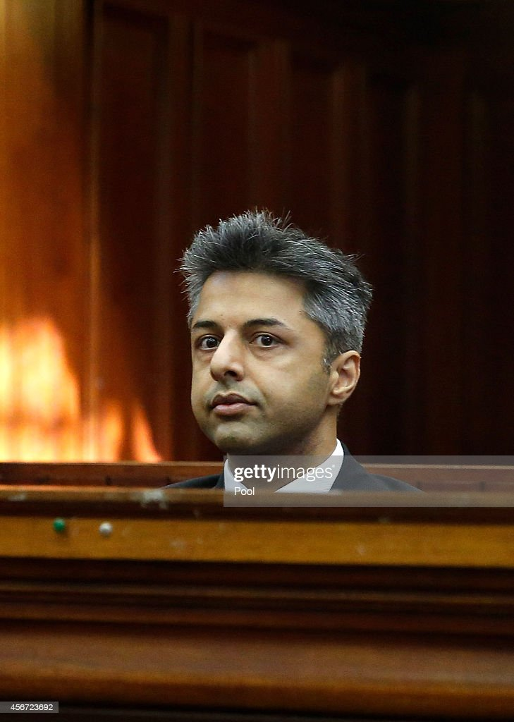 <a gi-track='captionPersonalityLinkClicked' href=/galleries/search?phrase=Shrien+Dewani&family=editorial&specificpeople=7343604 ng-click='$event.stopPropagation()'>Shrien Dewani</a> appears at Western Cape High Court for the start of his trial on October 6, 2014 in Cape Town, South Africa. The British businessman, who fought an extradition battle for three years, is accused of arranging the murder of his new wife in 2010, just days after their marriage. A South African taxi driver and two accomplices are serving prison sentences for their connection with the murder of Mrs Dewani.