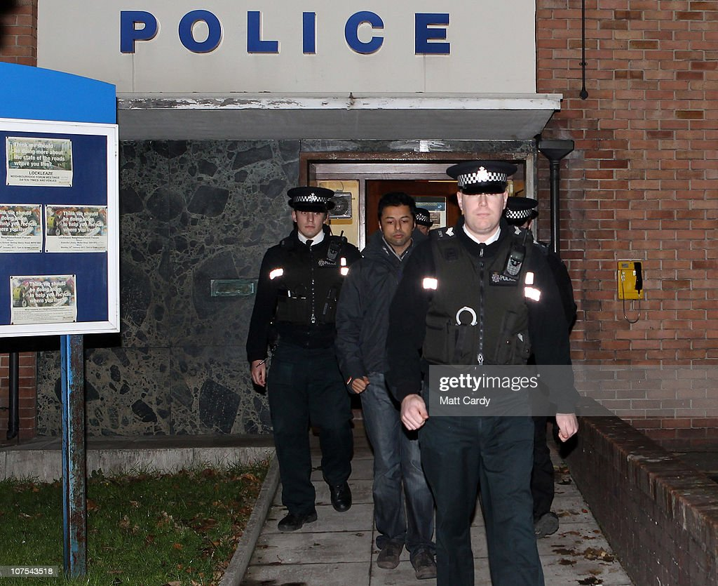 <a gi-track='captionPersonalityLinkClicked' href=/galleries/search?phrase=Shrien+Dewani&family=editorial&specificpeople=7343604 ng-click='$event.stopPropagation()'>Shrien Dewani</a> (centre) leaves Southmead Police station escorted by police officers after he reported there as part of his bail conditions on December 12, 2010 in Bristol, England. <a gi-track='captionPersonalityLinkClicked' href=/galleries/search?phrase=Shrien+Dewani&family=editorial&specificpeople=7343604 ng-click='$event.stopPropagation()'>Shrien Dewani</a> was granted bail on Friday after a hearing at the High Court. <a gi-track='captionPersonalityLinkClicked' href=/galleries/search?phrase=Shrien+Dewani&family=editorial&specificpeople=7343604 ng-click='$event.stopPropagation()'>Shrien Dewani</a>, is accused of conspiring to murder his new wife Anni Dewani, while on honeymoon in South Africa.