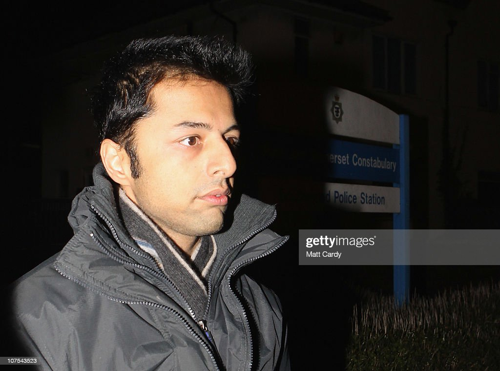 <a gi-track='captionPersonalityLinkClicked' href=/galleries/search?phrase=Shrien+Dewani&family=editorial&specificpeople=7343604 ng-click='$event.stopPropagation()'>Shrien Dewani</a> leaves Southmead Police station escorted by police officers after he reported there as part of his bail conditions on December 12, 2010 in Bristol, England. <a gi-track='captionPersonalityLinkClicked' href=/galleries/search?phrase=Shrien+Dewani&family=editorial&specificpeople=7343604 ng-click='$event.stopPropagation()'>Shrien Dewani</a> was granted bail on Friday after a hearing at the High Court. <a gi-track='captionPersonalityLinkClicked' href=/galleries/search?phrase=Shrien+Dewani&family=editorial&specificpeople=7343604 ng-click='$event.stopPropagation()'>Shrien Dewani</a>, is accused of conspiring to murder his new wife Anni Dewani, while on honeymoon in South Africa.