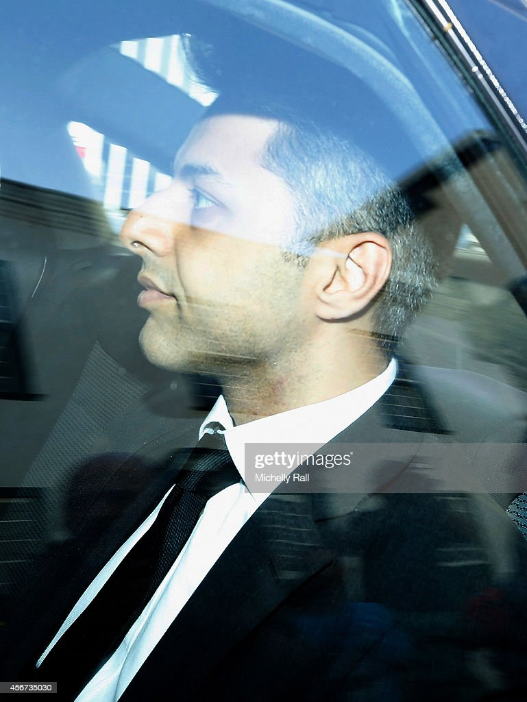 <a gi-track='captionPersonalityLinkClicked' href=/galleries/search?phrase=Shrien+Dewani&family=editorial&specificpeople=7343604 ng-click='$event.stopPropagation()'>Shrien Dewani</a>'s leaves Western Cape High Court after pleading not guilty to murdering his wife on their honeymoon in 2010, on October 6, 2014 in Cape Town, South Africa. The British businessman, who fought an extradition battle for three years, is accused of arranging the murder of his new wife in 2010, just days after their marriage. A South African taxi driver and two accomplices are serving prison sentences for their connection with the murder of Mrs Dewani.