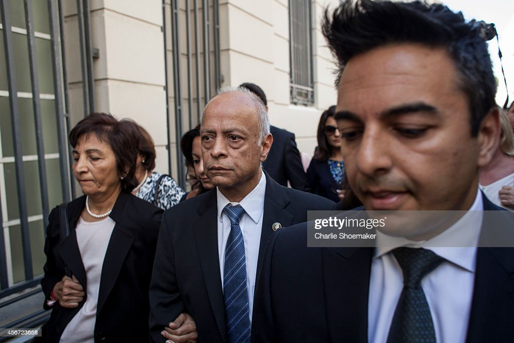 <a gi-track='captionPersonalityLinkClicked' href=/galleries/search?phrase=Shrien+Dewani&family=editorial&specificpeople=7343604 ng-click='$event.stopPropagation()'>Shrien Dewani</a>'s mother Snila Dewani (L), father Prakash Dewani (C) and brother Preyen Dewani (R) arrive at the Western Cape High Court for the start of their son's trial on October 6, 2014 in Cape Town, South Africa. The British businessman, who fought an extradition battle for three years, is accused of arranging the murder of his new wife in 2010, just days after their marriage. A South African taxi driver and two accomplices are serving prison sentences for their connection with the murder of Mrs Dewani.