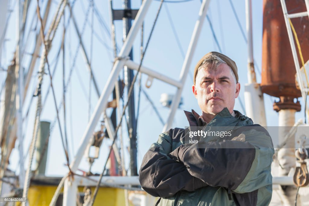 Shrimp boat captain on deck : ストックフォト