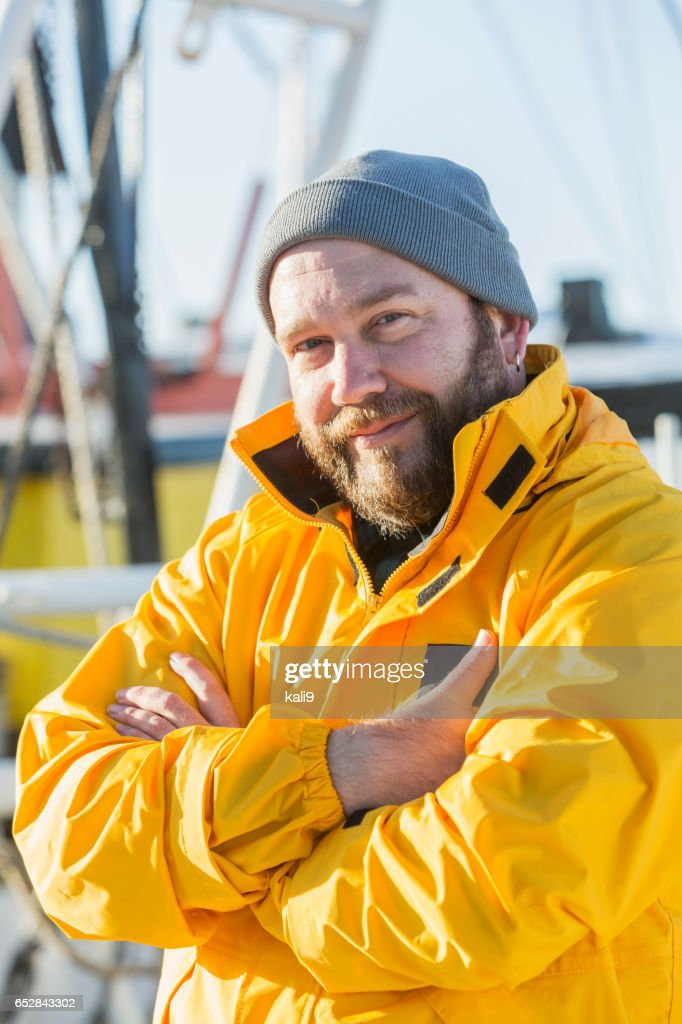 Shrimp boat captain on deck : Stock Photo