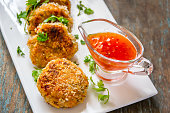 Deep Fried Shrimp Cakes - Delicious Appetizer Served in a Platter with Sweet Sauce.