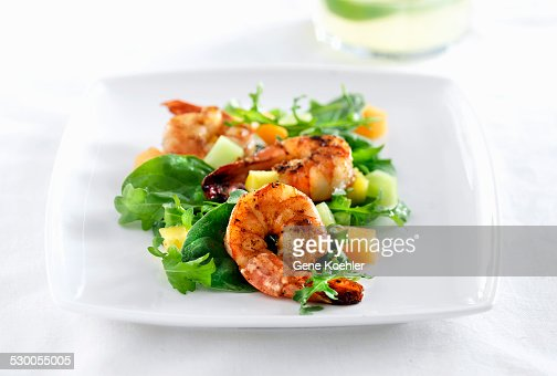Shrimp salad on white plate