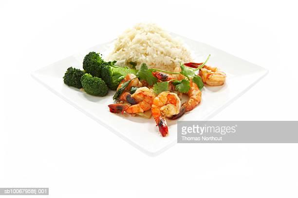 Shrimp stir fry on plate on white background