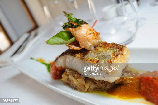 Shrimp tail and fried fish on top of onions, dish : Stock Photo