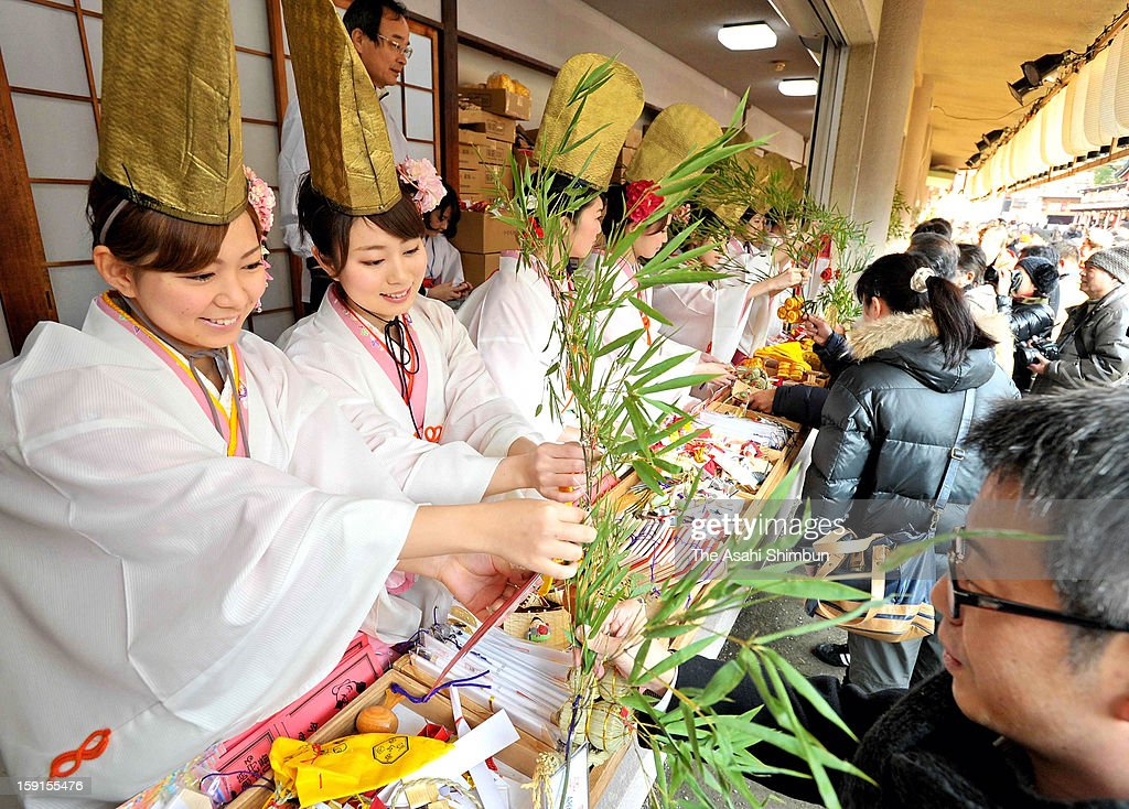 Shrine maidens called 'Fukumusune' or lucky attach ornaments to bamboo leaves 'Fukuzasa' or lucky bamboo, as Toka Ebisu festival begins at Imamiya Ebisu Shrine on Janaury 9, 2013 in Osaka, Japan. Toka Ebisu, to celebrate the Ebisu god on January 10 (toka), and the festival take place before and after 10th. The shrine expect 1 million visitors during the festival.
