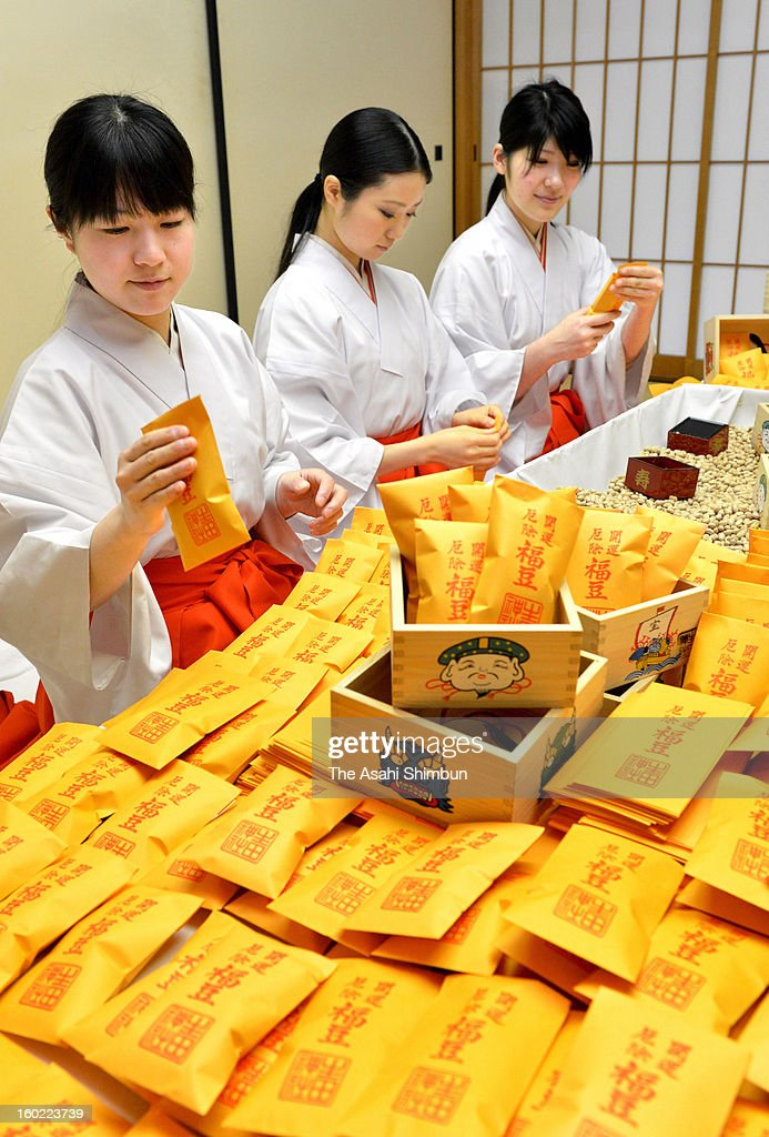 Shrine maidens package soybeans into small bags to be handed out on the Setsubun, a Japanese end of winter festivity at the beginning of February at Ikuta Shrine on January 22, 2013 in Kobe, Hyogo, Japan.