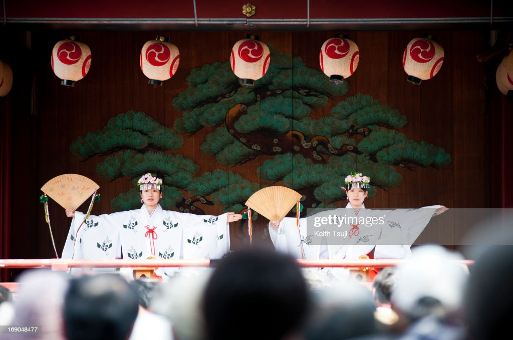 Shrine maidens perform in the Sanja Matsuri festival at the Asakusa Shrine on May 19 2013 in Tokyo Japan Sanja Matsuri is considered one of the...