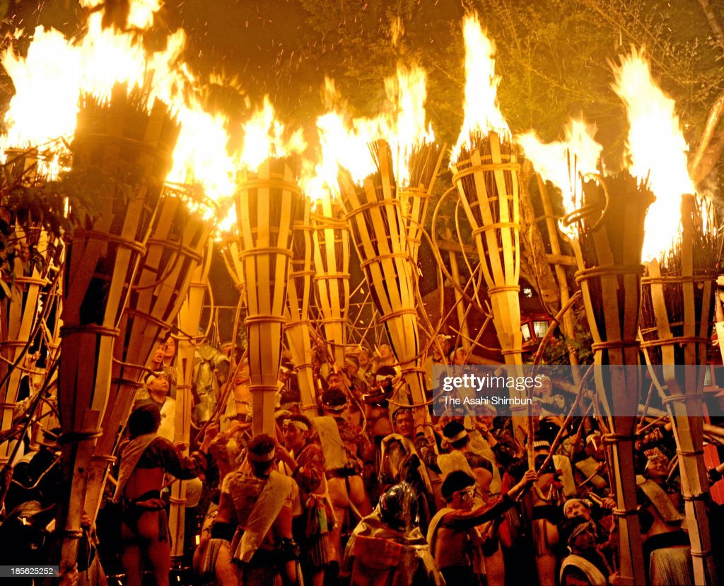 Shrine parishioners holding fire-burnt torches during the Kurama Fire Festival at Yuri Shrine on October 22, 2013 in Kyoto, Japan. The participants parade through the community carrying some 500 torches which measure five meters long and weigh 50 kilograms. The origin of this tradition dates back to the Heian Period when village members would build a bonfire to greet the deity of the shrine.