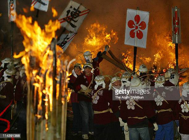 Shrine perishoners holding huge fans blow the smoke during the OnisubenoShinji purification ritual at Dazaifu Tenmangu Shrine on January 7 2003 in...