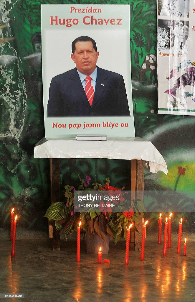 A shrine to the Late Argentine president Hugo Chaves is seen during a meeting of the Peasant Movement of Papaye (MPP) on March 18, 2013 in Poet-Au-Prince, Haiti. AFP PHOTO Thony BELIZAIRE