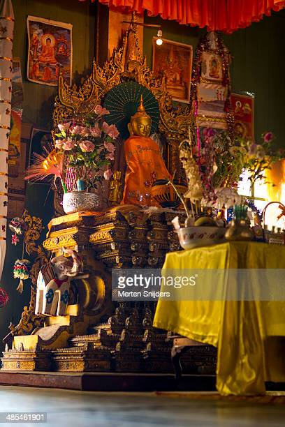 Shrine with offerings and Buddha statue