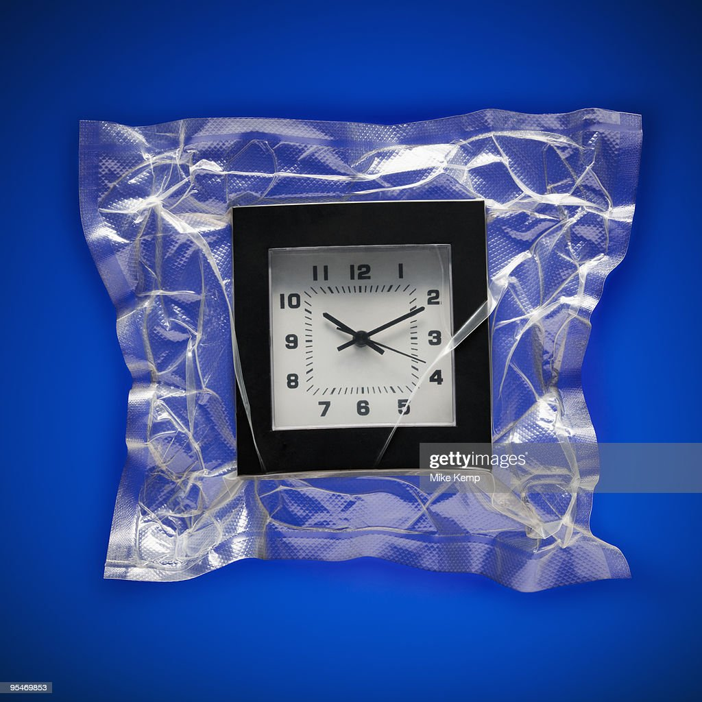 Shrink wrapped clock : Stock Photo