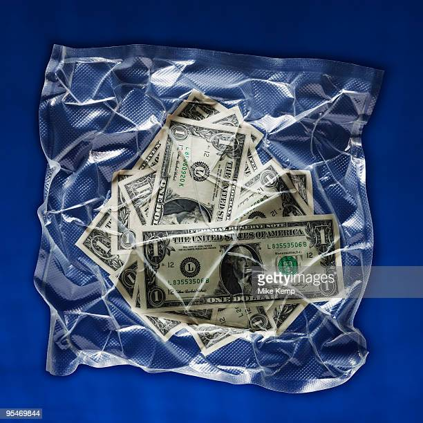 Shrink wrapped money