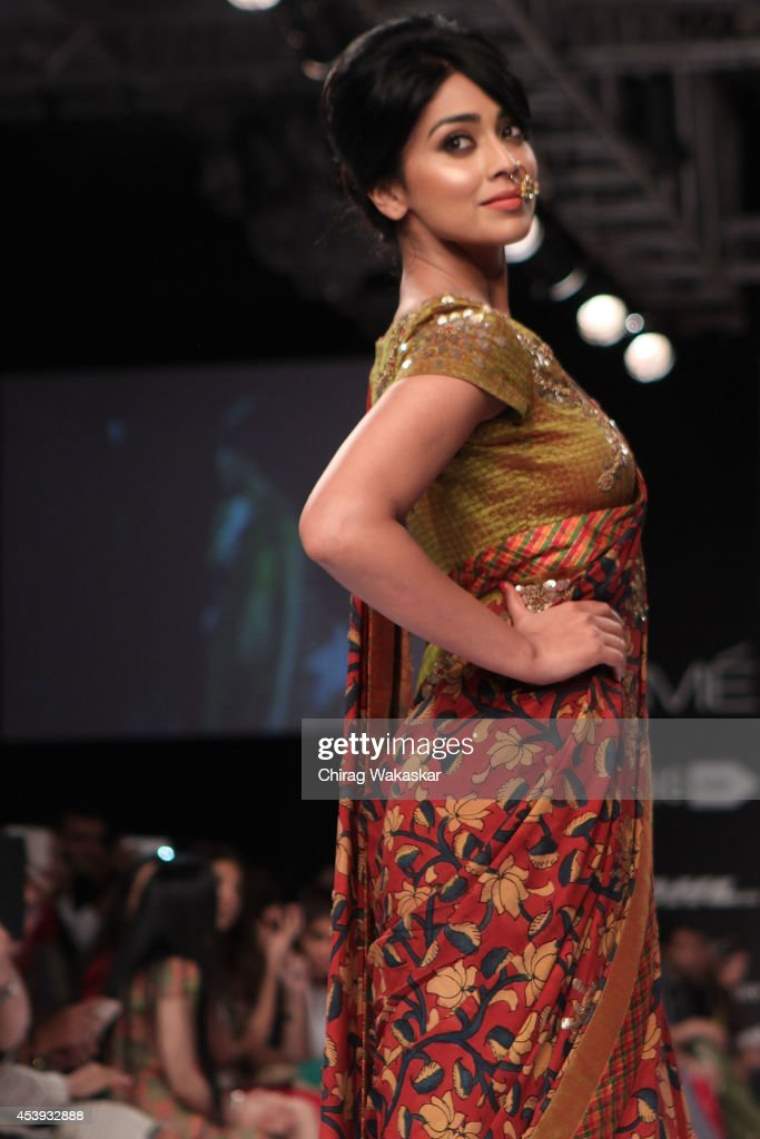 <a gi-track='captionPersonalityLinkClicked' href=/galleries/search?phrase=Shriya+Saran&family=editorial&specificpeople=5378055 ng-click='$event.stopPropagation()'>Shriya Saran</a> showcases designs by Sashikant Naidu during day 2 of Lakme Fashion Week Winter/Festive 2014 at The Palladium Hotel on August 21, 2014 in Mumbai, India.