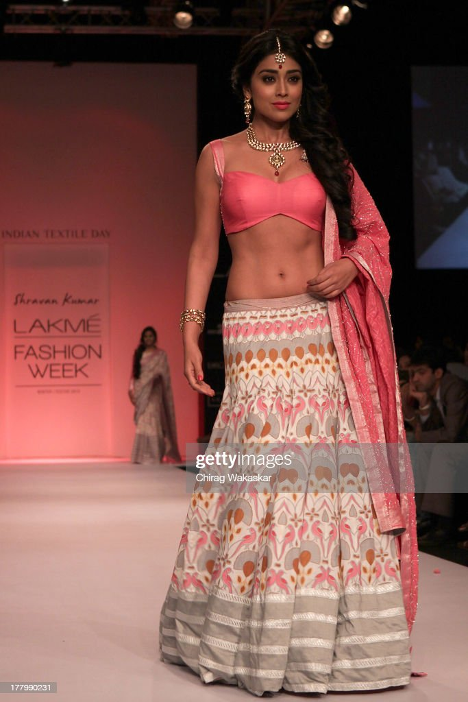 <a gi-track='captionPersonalityLinkClicked' href=/galleries/search?phrase=Shriya+Saran&family=editorial&specificpeople=5378055 ng-click='$event.stopPropagation()'>Shriya Saran</a> showcases designs by Shravan Kumar during day 4 of Lakme Fashion Week Winter/Festive 2013 at the Hotel Grand Hyatt on August 26, 2013 in Mumbai, India.