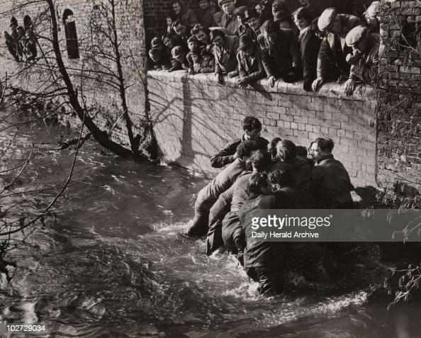 'Shrovetide football at Ashbourne' 1950 A photograph of players fighting for the ball in Henmore Brook during the Shrovetide football match in...