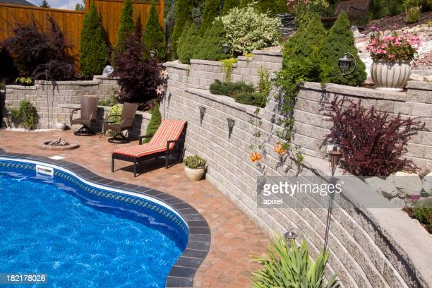 Shrubs and a deck chair by the pool