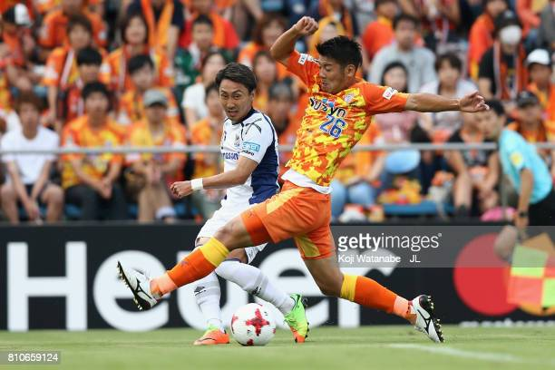 Shu Kurata of Gamba Osaka and Hiroshi Futami of Shimizu SPulse compete for the ball during the JLeague J1 match between Shimizu SPulse and Gamba...