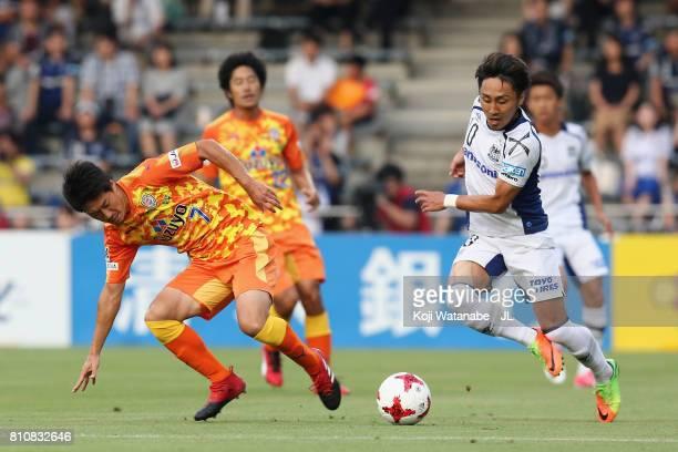 Shu Kurata of Gamba Osaka and Mitsunari Musaka of Shimizu SPulse compete for the ball during the JLeague J1 match between Shimizu SPulse and Gamba...