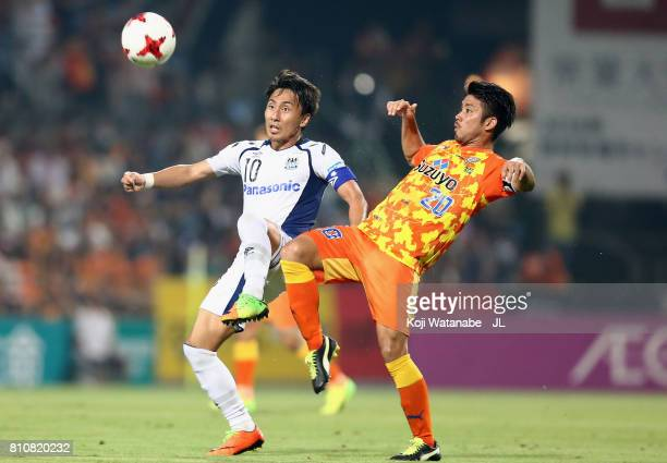 Shu Kurata of Gamba Osaka and Ryo Takeuchi of Shimizu SPulse compete for the ball during the JLeague J1 match between Shimizu SPulse and Gamba Osaka...