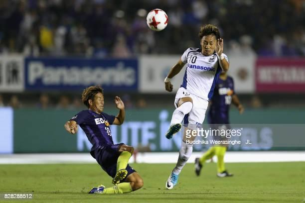 Shu Kurata of Gamba Osaka and Yoshifumi Kashiwa of Sanfrecce Hiroshima compete for the ball during the JLeague J1 match between Sanfrecce Hiroshima...
