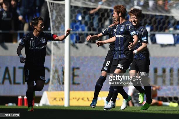 Shu Kurata of Gamba Osaka celebrates scoring his side's first goal to make it 11 with his team mates during the JLeague J1 match between Gamba Osaka...