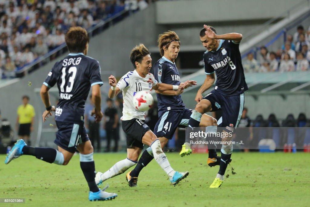 Shu Kurata of Gamba Osaka controls the ball under pressure of Jubilo Iwata defense during the J.League J1 match between Gamba Osaka and Jubilo Iwata at Suita City Football Stadium on August 13, 2017 in Suita, Osaka, Japan.