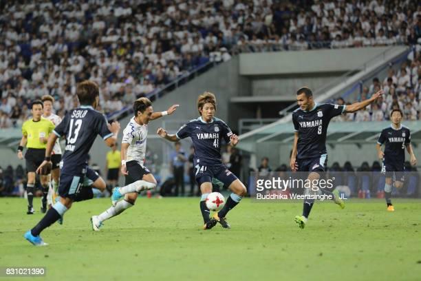 Shu Kurata of Gamba Osaka controls the ball under pressure of Jubilo Iwata defense during the JLeague J1 match between Gamba Osaka and Jubilo Iwata...