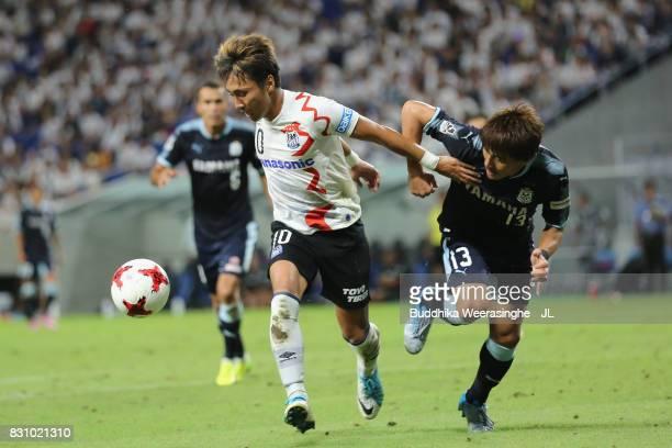 Shu Kurata of Gamba Osaka controls the ball under pressure of Tomohiko Miyazaki of Jubilo Iwata during the JLeague J1 match between Gamba Osaka and...