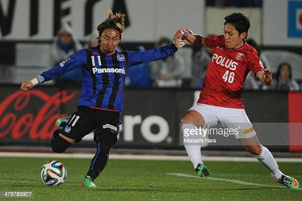 Shu Kurata of Gamba Osaka in action during the J League match between Gamba Osaka and Urawa Reds at Expo '70 Stadium on March 1 2014 in Osaka Japan
