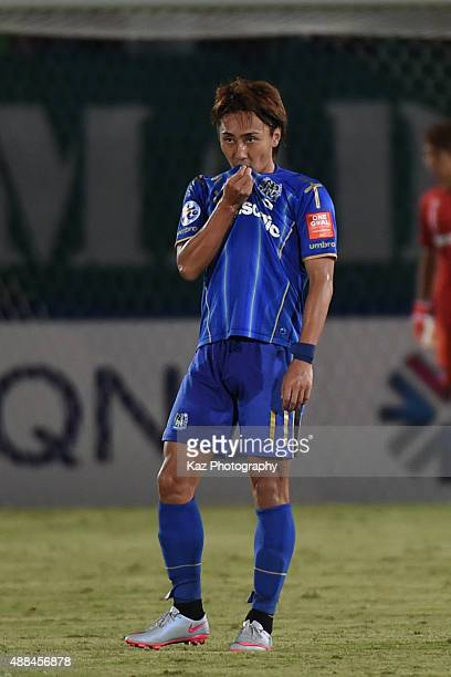 Shu Kurata of Gamba Osaka who scored the second goal kisses the emblem during the AFC Champions League quarter final match between Gamba Osaka and...