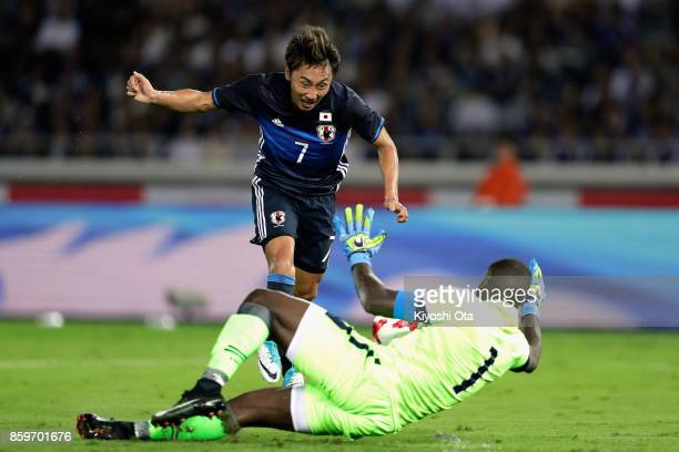 Shu Kurata of Japan and Johny Placide of Haiti compete for the ball during the international friendly match between Japan and Haiti at Nissan Stadium...