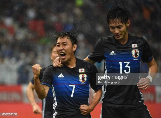 Shu Kurata of Japan celebrates scoring his side's second goal with his team mate Kenyu Sugimoto during the international friendly match between Japan...