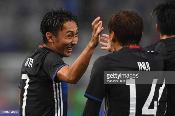 Shu Kurata of Japan celebrates scoring his side's second goal with his team mate Takashi Inui during the international friendly match between Japan...
