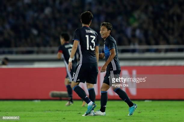 Shu Kurata of Japan celebrates scoring the opening goal with his team mate Kenyu Sugimoto during the international friendly match between Japan and...