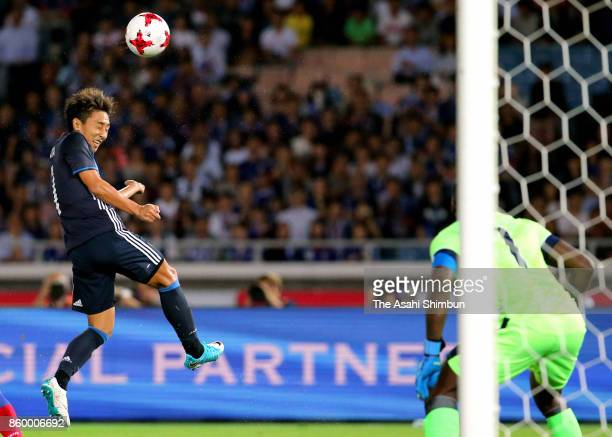 Shu Kurata of Japan heads to score the opening goal during the international friendly match between Japan and Haiti at Nissan Stadium on October 10...