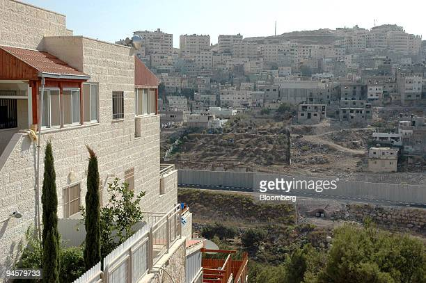 Shuafat a Palestinian refugee camp sits in the distance as the West Bank barrier divides it from the Jewish neighborhood of Pisagat Ze'ev in...