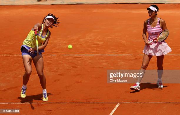 Shuai Peng of China and SuWei Hsieh of Taipei in action against Sara Errani and Roberta Vinci of Italy during their final match on day eight of the...