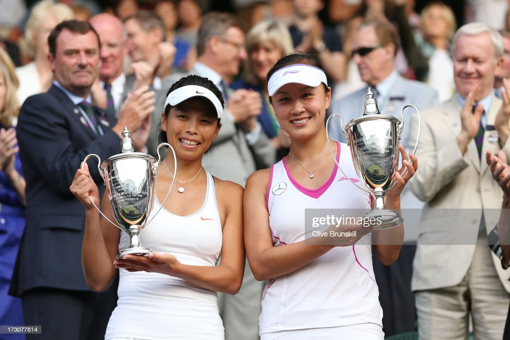 Shuai Peng (R) of China and Su-Wei Hsieh of Taipei pose with the Ladies' Doubles trophies after their Ladies' Doubles final match against Ashleigh Barty of Australia and Casey Dellacqua of Australia on day twelve of the Wimbledon Lawn Tennis Championships at the All England Lawn Tennis and Croquet Club on July 6, 2013 in London, England.