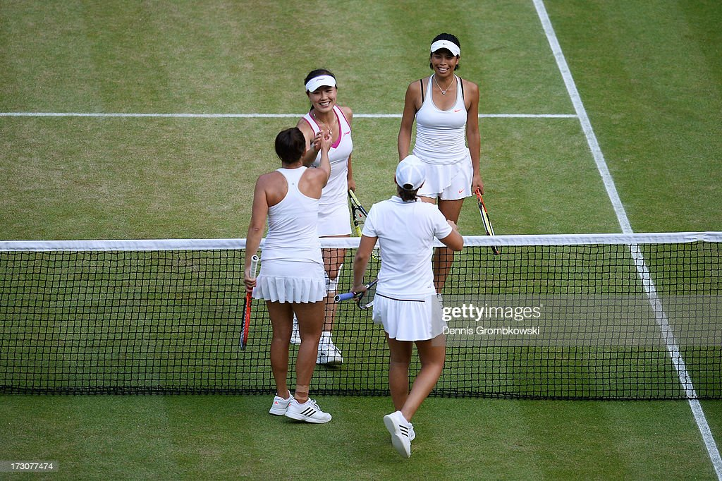 Shuai Peng of China and Su-Wei Hsieh of Taipei shake hands at the net with Ashleigh Barty of Australia and Casey Dellacqua of Australia after their Ladies' Doubles final match on day twelve of the Wimbledon Lawn Tennis Championships at the All England Lawn Tennis and Croquet Club on July 6, 2013 in London, England.