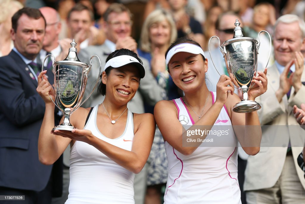 Shuai Peng (R) of China and Su-Wei Hsieh of Taipei smile as they pose with the Ladies' Doubles trophies after their Ladies' Doubles final match against Ashleigh Barty of Australia and Casey Dellacqua of Australia on day twelve of the Wimbledon Lawn Tennis Championships at the All England Lawn Tennis and Croquet Club on July 6, 2013 in London, England.
