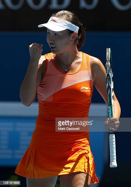 Shuai Peng of China celebrates in her second round match against Jelena Jankovic of Serbia during day four of the 2011 Australian Open at Melbourne...