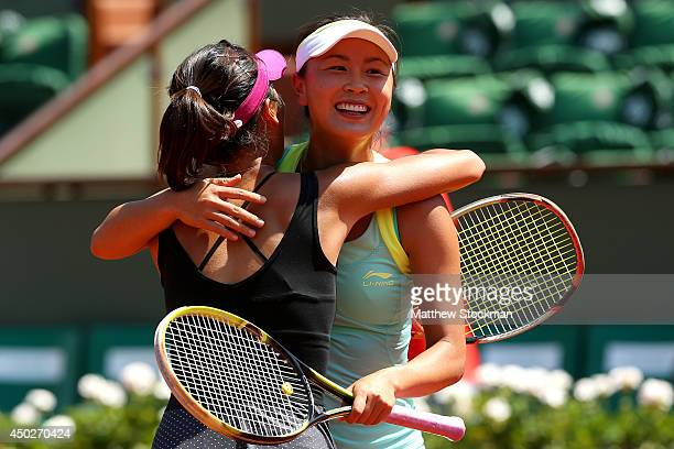 Shuai Peng of China celebrates match point with SuWei Hsieh of Chinese Taipei after their women's doubles final match against Sara Errani of Italy...