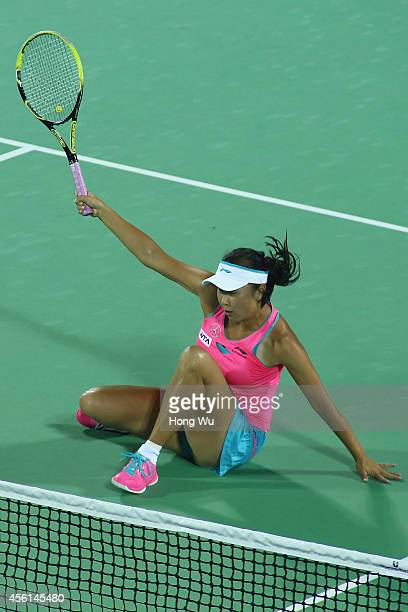 Shuai Peng of China falls down during the doubles match against Cara Black of Zimbabwe and Caroline Garcia of France on day six of 2014 Dongfeng...