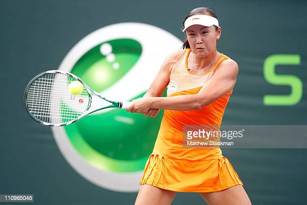 Shuai Peng of China hits a return against Alexandra Dulgheru of Romania of during the Sony Ericsson Open at Crandon Park Tennis Center on March 28...