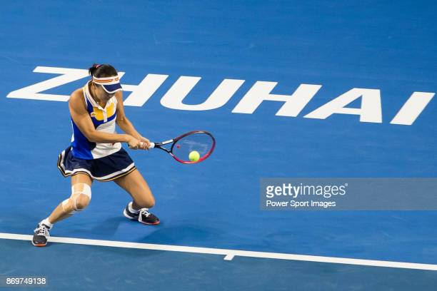 Shuai Peng of China hits a return during the singles Round Robin match of the WTA Elite Trophy Zhuhai 2017 against Elena Vesnina of Russia at Hengqin...
